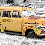 Yellow carryall bus